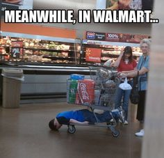 Meanwhile, in Walmart... - Kid sleeping with his head on the ground laying under the shopping cart of an old lady...Only at WalMart
