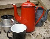 Old french red enamel coffee pot with enamel mugs