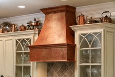 Faux copper stove hood painted by Linda Gale Boyles