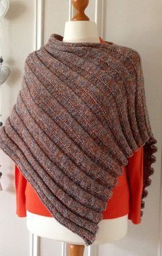 Free Knitting Pattern for Easy Peasy Poncho - Knit flat in one rectangle. DK yarn. Rated very easy by Ravelrers. Designed by Tina Irving. Pictured project by kathinka14