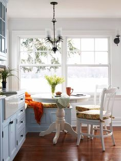 Position a breakfast nook to overlook a view of the outdoors. More eat-in #kitchens: http://www.bhg.com/kitchen/eat-in-kitchen/eat-in-kitchens/
