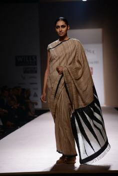 ABRAHAM AND THAKORE. I love the variation in the saree.