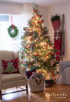 Ideas for creating decorating a Christmas tree in a cozy farmhouse style with crocheted snowflakes, velvet ribbon, burlap ribbon, and more.