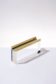 Thévoz-Choquet's polished brass accessories are half-cast in transparent resin blocs, allowing one half to oxidize while the other remains pristine forever. Desktop Accessories, Home Accessories, Teak Sideboard, Rustic Room, Office Items, Corporate Gifts, Jewellery Display, Polished Brass, Visual Merchandising