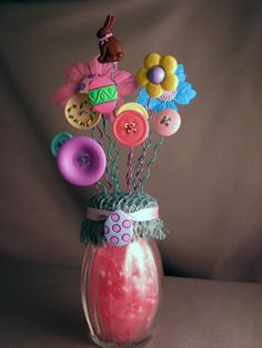 Spring Chocolate This Button Bouquet will look awesome sitting with any Easter or Spring holiday decor! Approximately 6 - 6 & 1/2 tall. These are great little decorative items. They can go anywhere; a desk, bookshelf, mantle, dresser.... anywhere. They make fabulous gifts for young