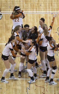 Texas Volleyball celebrates their national championship win.