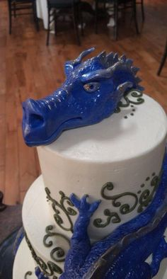 Buttercream cake with sculpted modeling chocolate dragon.