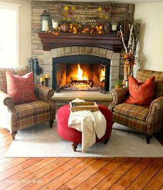 Corner stone fireplace with plaid Bassett chairs and I like the items on the fireplace and mantle