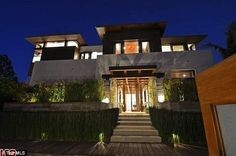 Welcome: The entry to the home is impressive with wide steps leading up to a large door un...