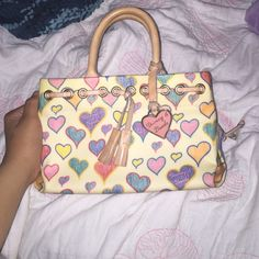 ADORABLE HEART DOONEY AND BURKE PURSE adorable little heart purse w chain!it's in really good condition except for the two little stains inside! it's so pretty just a little to small for me. NO TRADES!! WILL TAKE OFFERS Dooney & Bourke Bags Mini Bags