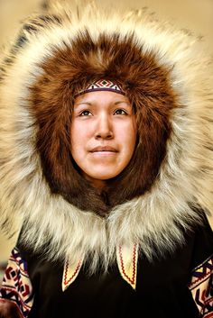Inuk - A beautiful Inuk woman in her traditional clothing in Cambridge Bay, Nunavut Canada