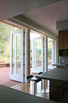 Multiple French doors. If you have an expanse of unconnected windows and doors and would like to open up the space up without going through a huge remodel, multiple hinged French doors may be your answer.