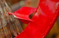 Red; Mockingjay detail; Tuck & Holand Metal Sculptors; Vineyard Haven, Martha's Vineyard, Massachusetts, USA.  August 2014.
