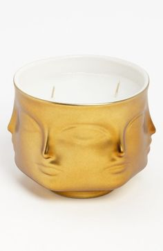 Jonathan Adler 'Muse D'Or' Candle Gold  | Mythic faces gaze around a gilt-dipped candle scented with fresh notes of pink pepper and sage balsam. After the candle is gone, use the porcelain pot for fresh flowers or sweet treats. #candle #jonathanadler #gold