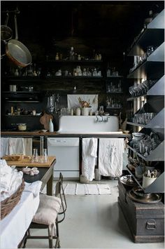 moody and rustic kitchen. love the shelving!