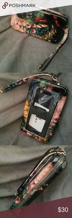 Mundi cell phone wallet wristlet NWOT. Fits android phone such as Samsung S5 active sizes. Or you can also use it to store cash or cards as there is a Velcro strap to keep it in place and from falling out when you open it.  Feel free to ask any and all questions before purchase. Have a blessed day! ✌💚😄 Mundi Bags Clutches & Wristlets