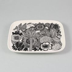 Marimekko  Siirtholapuutarha Small Rectangle Plate: Small rectangle plate from Danish design house, Marimekko. With a floral monochrome design, this plate is designed to be mixed and matched with other Marimekko items and is perfect for using for tea and cake, or morning toast.