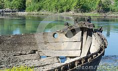 An old riverboat that decomposes on the shore