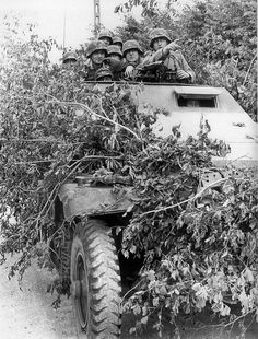 Grenadiers of the German 130 Panzer-Lehr-Division, 5th Panzer Army (Panzer Group Eberbach) on lookout for Canadian and British troops during the Battle for Caen.
