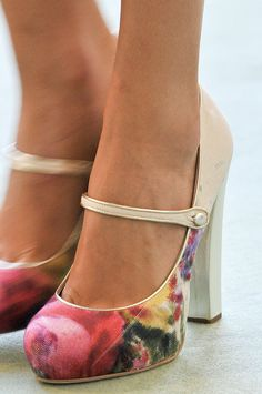 These kind of remind me of the flapper-style shoes of the twenties with the straps in the front. Really cute!