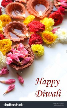 stock-photo-diwali-candles-and-oil-lamps-with-flowers-on-a-white-background-334727054.jpg (996×1600)