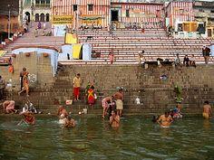 Pilgrims bathing at Kedar Ghat at sunrise. Varanasi, Uttar Pradesh, India
