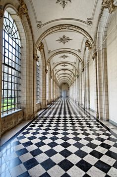 black and white floor, arched winodws