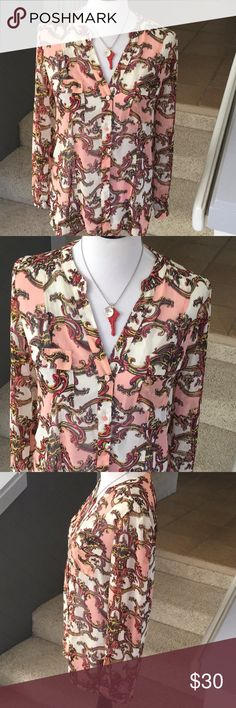 """Candies Pink, Red & White Floral Pattern Blouse Candies pink, red and white floral pattern long sleeve button down sheer blouse.  I think it's a large or XL but it's the missing size tag, in great shape.  Approx. 31"""" long in back, 26"""" long in front,  40"""" chest,  24"""" sleeves. Happy to answer questions, thanks!❤️ Candies Tops Blouses"""