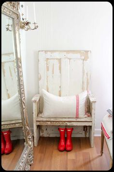 really don't like the floor but i'm loving the chippy repurposed door into chair, the mirror and the red wellington boots :)