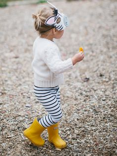 yellow rain boots and stripes