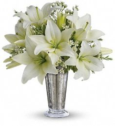 Written in the Stars: Elegant white lilies and pretty white waxflower stems are exquisitely arranged in a silver Mercury Glass Antique vase that's reminiscent of a star-filled sky. It really is a wish come true.