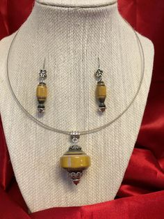 Yellow Ocra Paper Bead Pendant & Earring set by ABBOCREATIONS on Etsy https://www.etsy.com/listing/236345583/yellow-ocra-paper-bead-pendant-earring