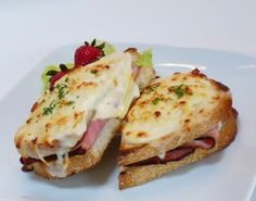 """There are as many versions of this classic French sandwich as there are Parisian cafes that have it on their menus. The Croque Monsieur, or """"Crispy Mister"""" appeared on French menus in 1910 and was simply a ham and Gruyere sandwich fried in butter. A good one is typically topped with either extra grated cheese [Read More]"""