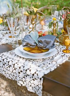 A picture perfect table top setting for a garden wedding. Sitting on Sublime Angel Lace, white bone china, wood table, crystal clear glassware and napkins from Classic Party Rentals in El Segundo, and design elements, colored glass and botanicals from Krista Jon.