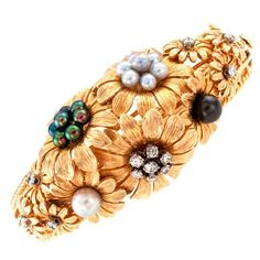 1960s Cultured Pearl Diamond Gold Flower Bangle Bracelet | From a unique collection of vintage bangles at https://www.1stdibs.com/jewelry/bracelets/bangles/