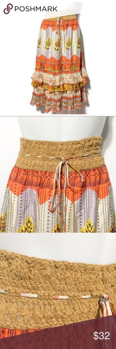 Free People Boho Warm Color Ruffle Skirt SZ M Absolutely gorgeous skirt by Free People! The warm colors of vibrant rusts, soft orange and golds are accented by beautiful bohemian pattern and design. The wide waist and is stretchy, with an elasticized stretch. The tie that slides through the waistline adds another classic FP edge. Short lining under the beautiful flowing layers. In EUC. Enjoy! Length is 31. Free People Skirts