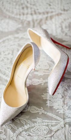 Christian Louboutin shimmery white heels // Pinned by Dauphine Magazine, curated by Castlefield (wedding invitation, branding, pattern designs: www.castlefield.co). International Couture Fashion/Luxury Wedding Crossover Magazine - Issue 2 now on newsstands! www.dauphinemagaz.... Instagram: @ dauphinemagazine / @ castlefieldco. Dauphine and Castlefield only claim credit for own images.