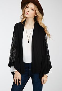 With an effortlessly upscale look reminiscent of a vintage treasure, this open-front kimono is a must-have for anyone who prides themselves on having a one-of-a-kind style. From its ornate lace panels at its back and wide, billowy long sleeves to its textured crepe fabrication, this piece strikes the perfect balance between luxe and laid-back.