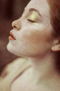 freckles, gold shadow, coral lip