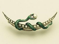 A fine and impressive antique Victorian ruby and pearl, 15 carat yellow gold, green enamel snake crescent brooch; part of our antique jewellery / estate jewelry collections