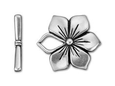 Purchase this antique silver-plated pewter flower toggle clasp at Artbeads.com, a flower-shaped toggle clasp made from lead-free pewter with a large surface finished with a vintage silver color.
