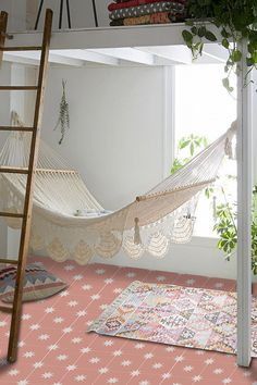 A hammock is the perfect place to recline and relax. Install an indoor hammock for beachy relaxation all year long. For more indoor hammock design ideas, visit domino. Dream Rooms, Dream Bedroom, My New Room, My Room, Spare Room, Indoor Hammock, Tile Decals, Bathroom Decals, Attic Bathroom