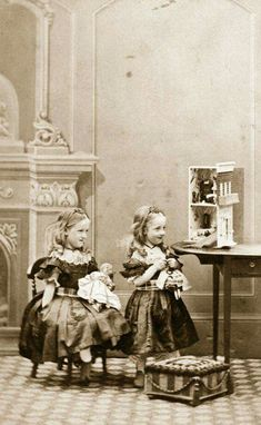Victorian little girls with dolls and their doll house!