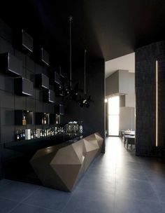 The entrance to the bar is the filter access to the dining rooms and the dark colour that characterizes it makes the transition more evocative. The wall of the bar is covered with lacquered panels with luminous inserts, while the counter is made of lacquered fiberglass with bronze metallic paint.
