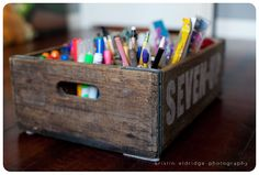Vintage soda crate for storing kid's art supplies (very cute! plus it looks grown up too)