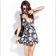 Black and white floral halter Open cross back, never worn, super comfy I just don't like the fit on me unit for exposure UNIF Dresses