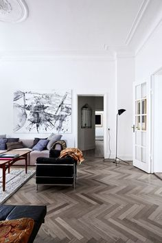 Modern Parisian chic with contemporary art and gorgeous plaster work