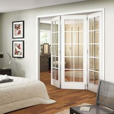 http://www.justsoakit.com/wp-content/uploads/2015/01/gorgeous-folding-glass-door-in-the-indoor-design-set-on-the-bedroom-as-well-frame-on-the-wall-also-white-duvet-cover-plus-chair-on-the-rug-along-with-hardwood-flooring-870x870.jpg