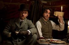 Still of Jude Law and Robert Downey Jr. in Sherlock Holmes: A Game of Shadows