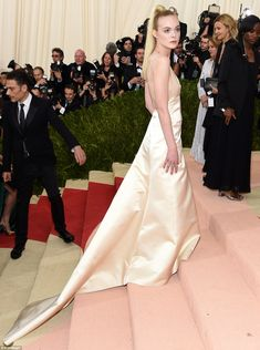 Elle Fanning wowed in cream satin as she walked the steps of the Met Museum